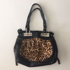 B. Makowsky leather and leopard print bag.